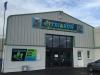 Signs on aluminium composite panel fixed to cladding on building