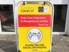covid-pavement-sign