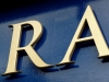 Individual solid letters finished in metallic gold paint