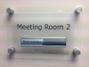 Meeting Room plate fixed to wall with anodised aluminium stand-off fittings