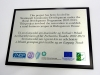 Brushed effect aluminium plaque mounted on a base plate