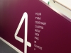 Self-adhesive lettering applied to internal walls in Ericsson facility