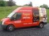 Partial vehicle wrap and metallic self-adhesive lettering applied to van
