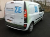 Digitally printed images and self-adhesive lettering applied to van