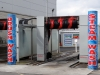 Self-adhesive graphics produced and applied to car wash structure