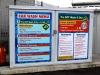 Car wash menu graphics applied to doors of wash storage unit